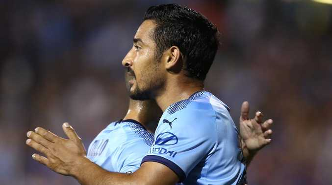 Sydney FC forward Reza Ghoochannejhad (right) celebrates with teammate Michael Zullo after scoring against Adelaide United on Friday night. Picture: Getty Images