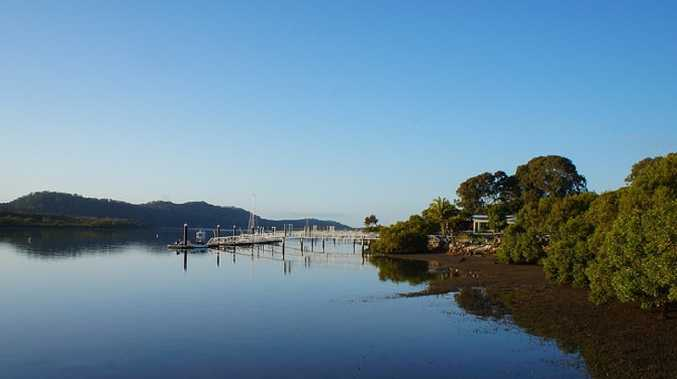 Emergency transfer times off Russell Island are under the microscope after a 75-year-old man took more than six hours to get to a major mainland hospital for treatment of chest pains.