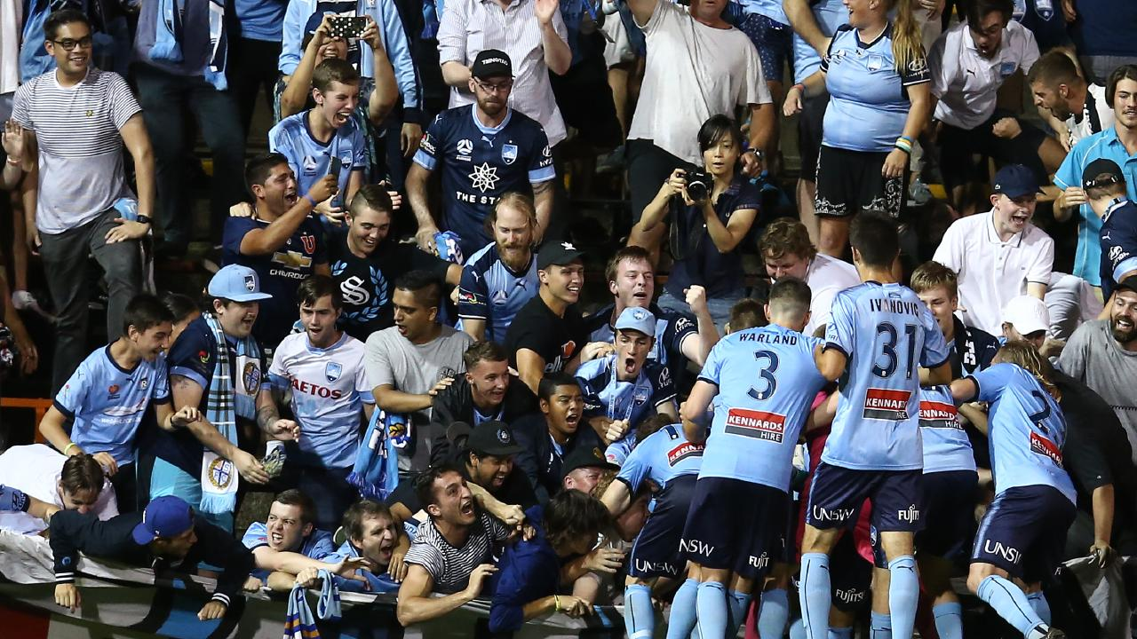 The fence at Leicchardt Oval collapses under teh weight of Sydney FC fans celebrating Cameron Devlin's goal. Fortunately no one was seriously hurt. Picture: Getty Images