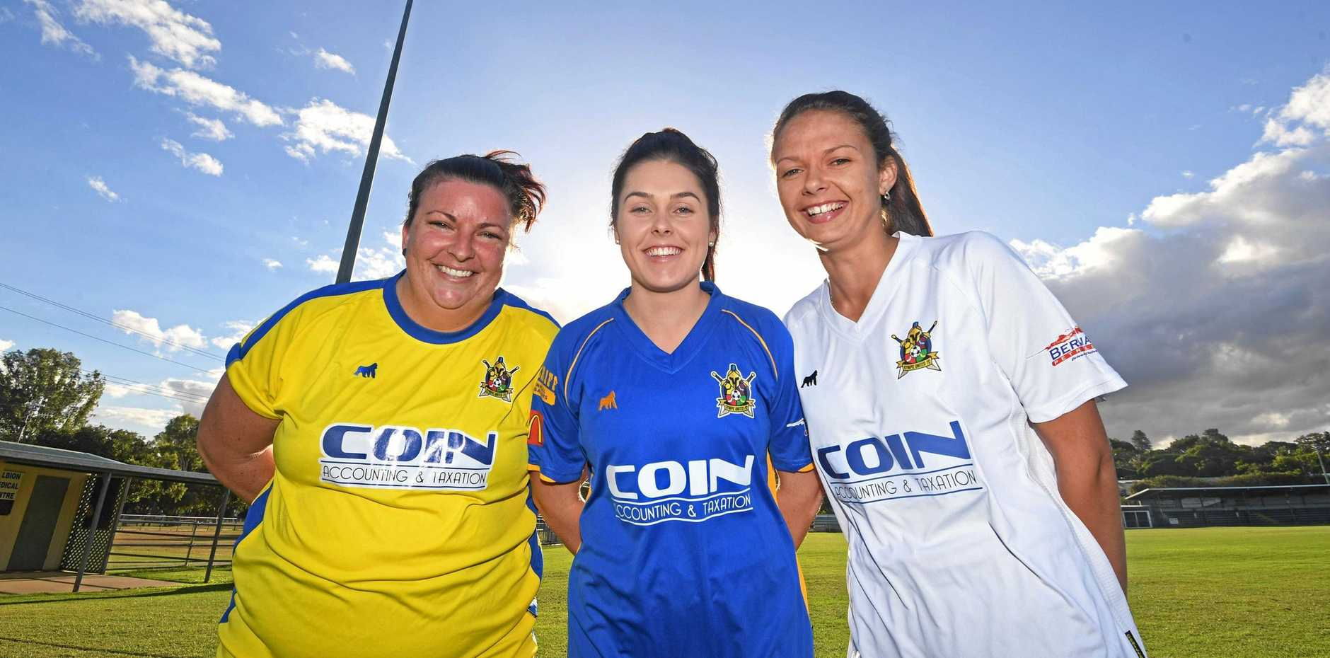 EXPANDED: Gympie United Gladiators players Vanessa Weaver, Chloe Vidler and Sammie Sutton show off the new Gympie United Gladiators women's strips for their inaugural season this year.