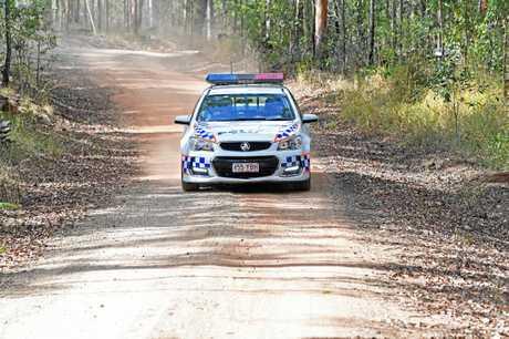 Police and fire crew investigate abseiler death scene near Gympie