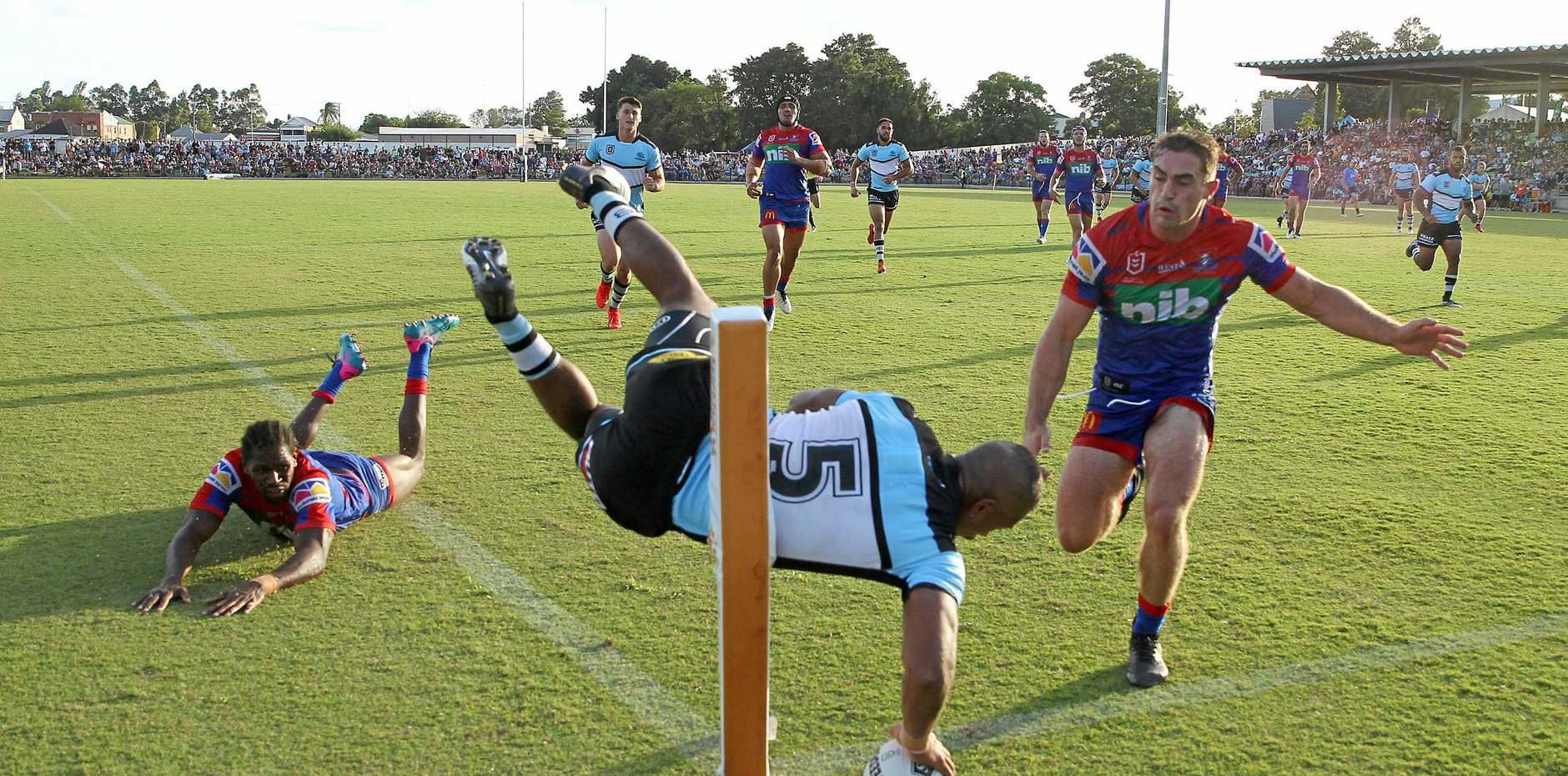 Cronulla's Sione Katoa scores a try during the Sharks' NRL trial match against the Newcastle Knights in Newcastle on Saturday. Picture: Tony Feder/Getty Images