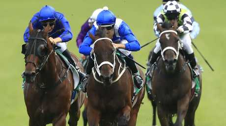 Winx reels in Happy Clapper to win her 31st successive race in the Chipping Norton Stakes. Picture: Getty Images