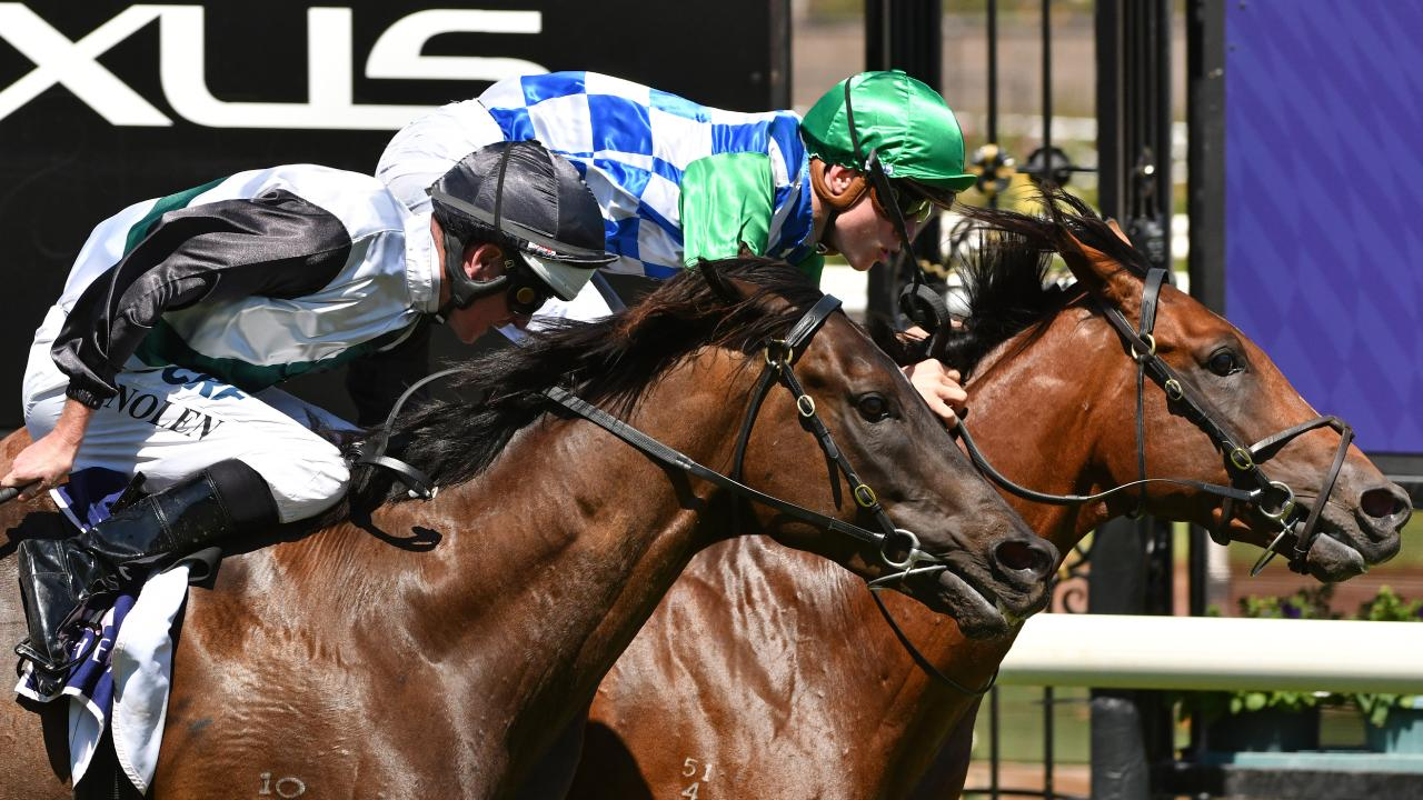 Ben Allen and Fifty Stars (right) take out the Group 2 Blamey Stakes at Flemington on Saurday. Picture: Quentin Lang/AAP