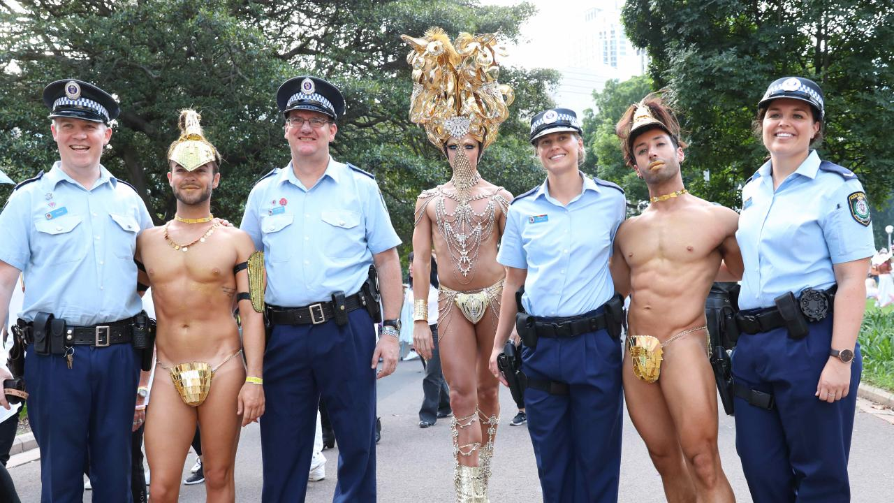 Bruno Almeida, Joshua Heath, Daniel Franklin with NSW police before the start of the Sydney Gay and Lesbian Mardi Gras Parade. Picture: Damian Shaw