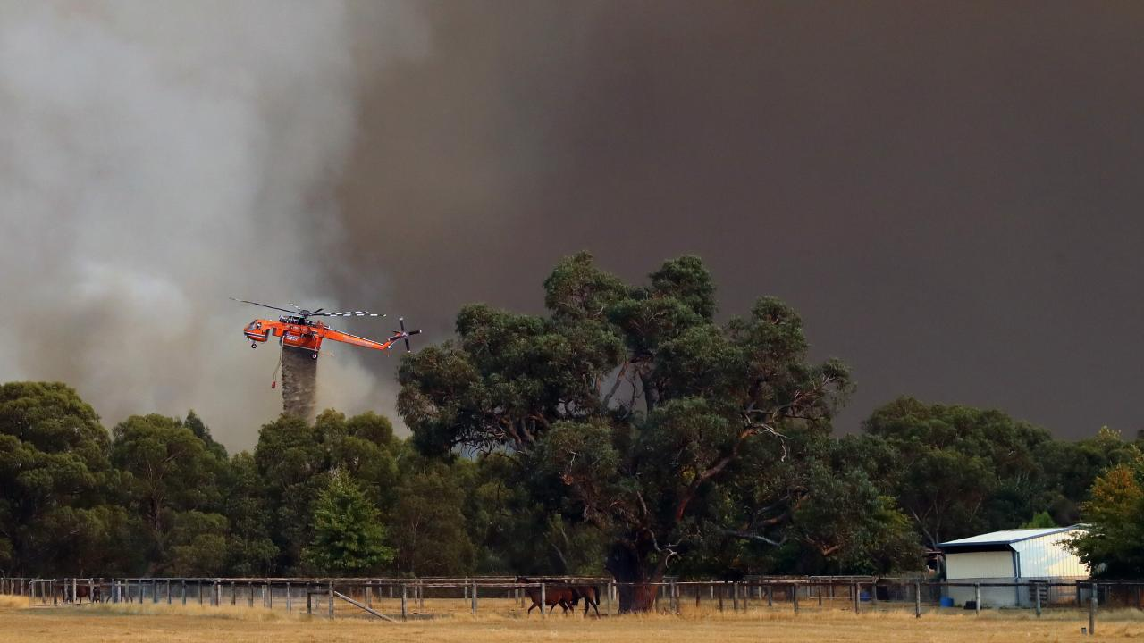 A CFA helicopter responds in Bunyip State Park. Picture: Alex Coppel