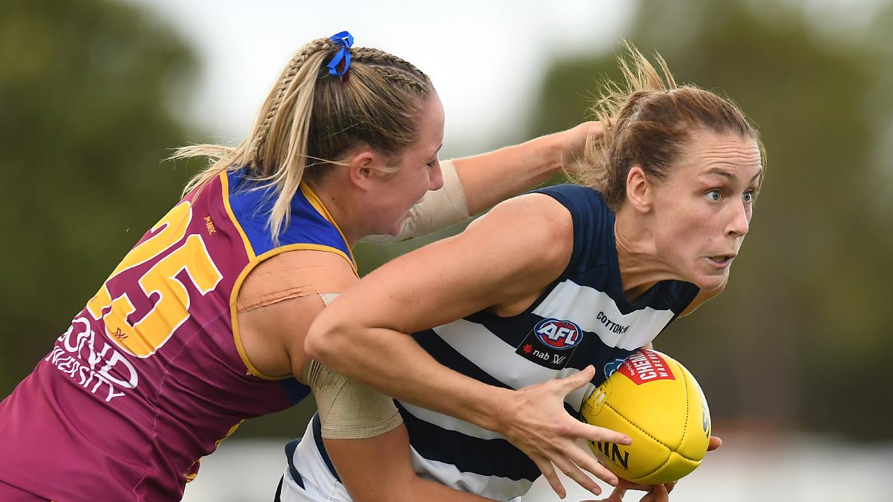 Madaleine McMahon of the Cats is tackled by Jacqui Yorston of the Lions during their round five clash. (Photo by Albert Perez/Getty Images)