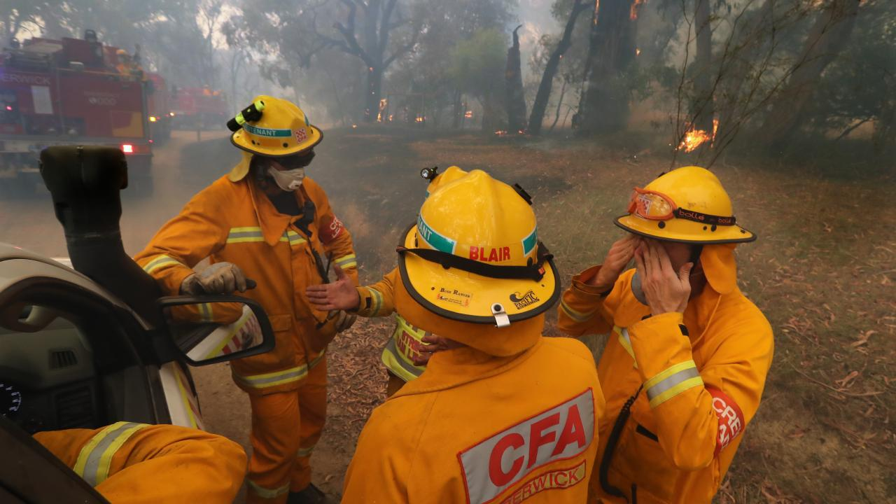CFA members discuss their fire plan in Bunyip State Park. Picture: Alex Coppel