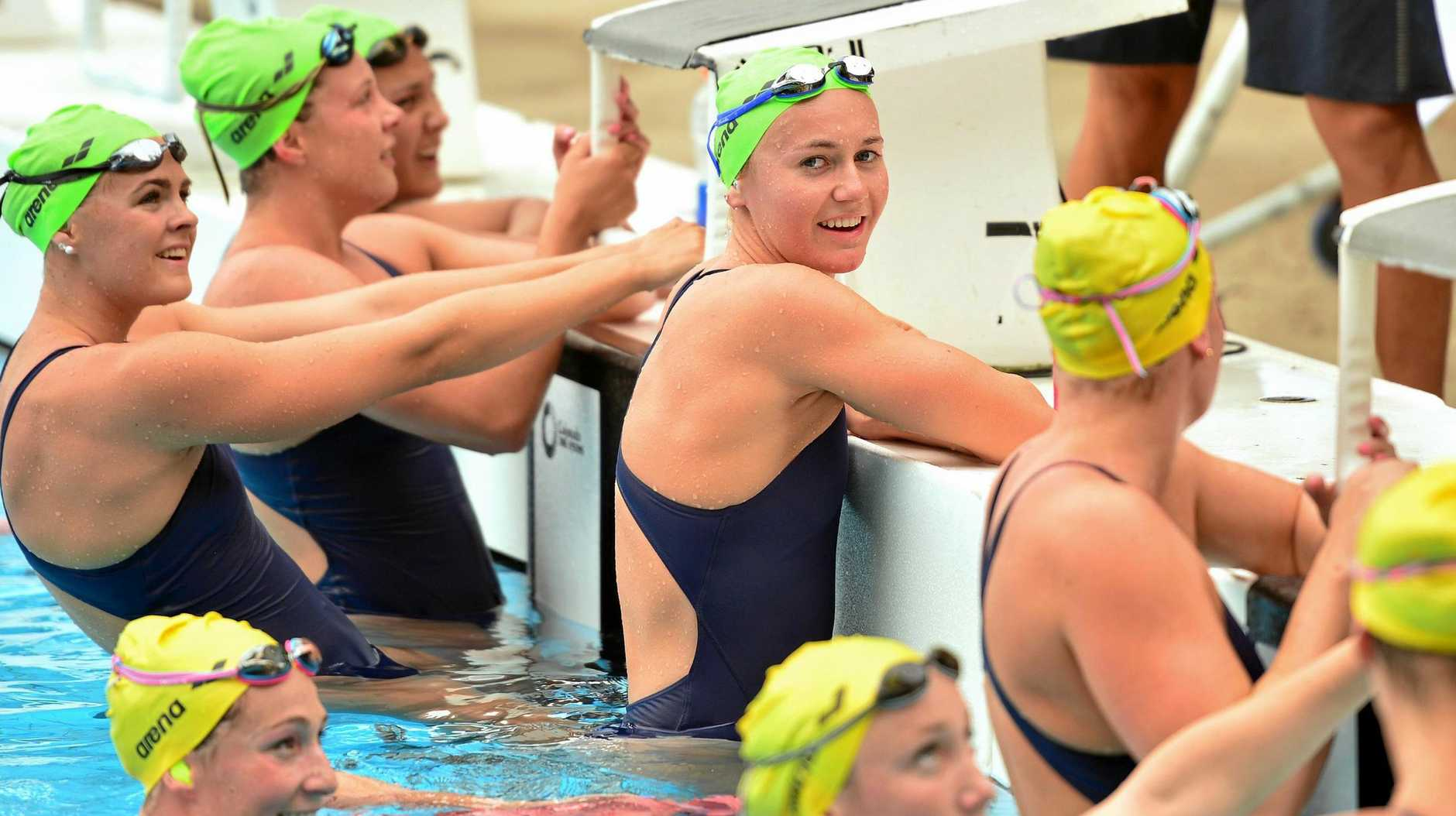 TRAINING GROUP: Ariarne Titmus, centre, with the Australian women's 200m freestyle and relay squad at Noosa Heads on Saturday.