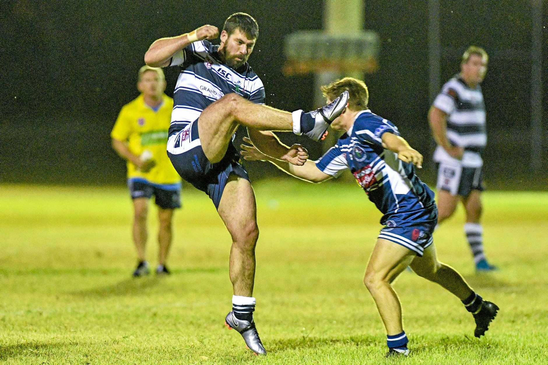 Tyrone Lockrey is tackled after kicking ball for Gladstone Brothers against Rockhampton Brothers.