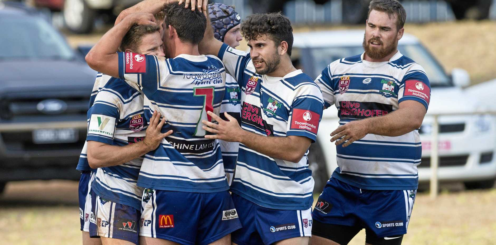 Brothers celebrate a Kyle Wagner (left) try at Glenholme Park on Saturday.