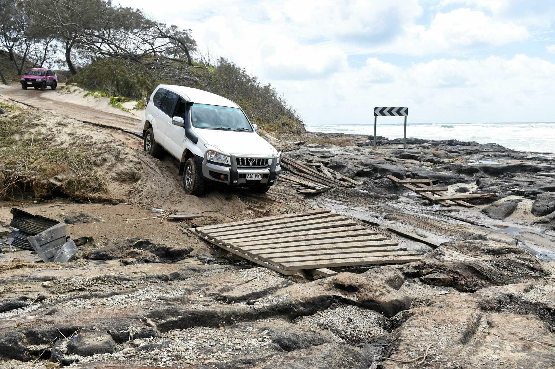 Fraser Island - negotiating the rocks on the southern side of Poyungan Rocks.