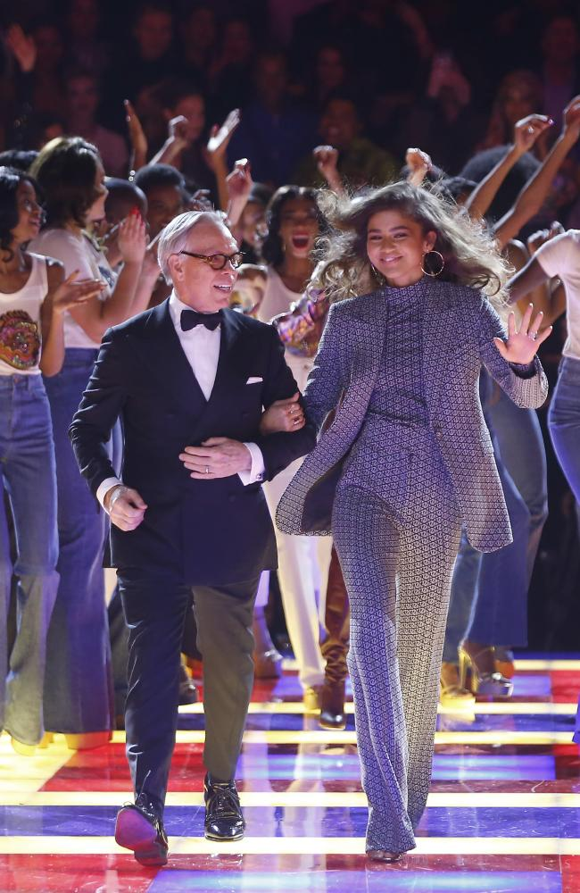 Taking a bow! Tommy Hilfiger, left, and Zendaya at the end of their show in Paris. Picture: AP Photo/Michel Euler