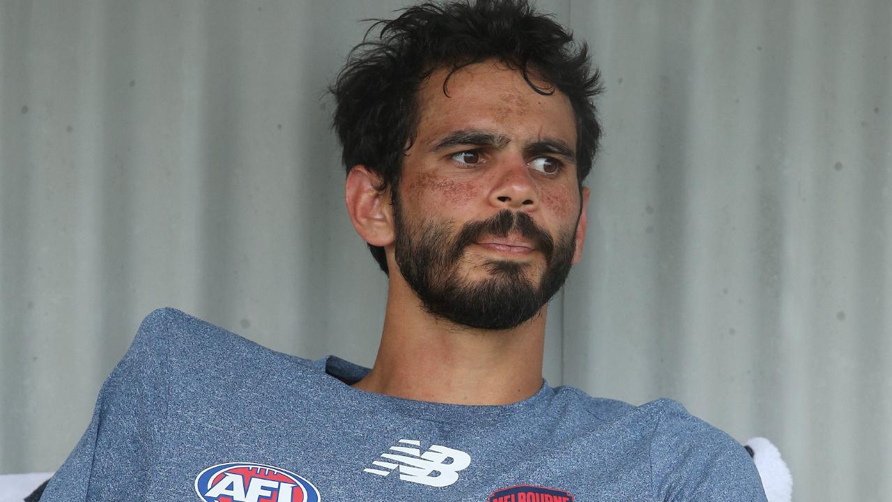 Melbourne's Jeff Garlett on the bench after dislocating his shoulder. Picture: Michael Klein