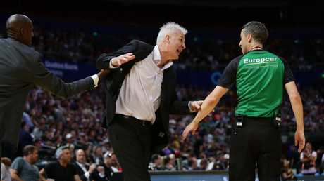 Lanard Copeland pulls Andrew Gaze away from the referee. Picture: Brett Costello