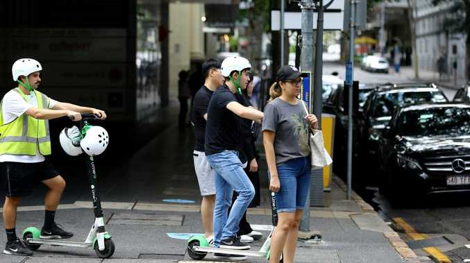 Lime scooters have proved a hit in Brisbane's inner suburbs. Picture: David Clark/AAP