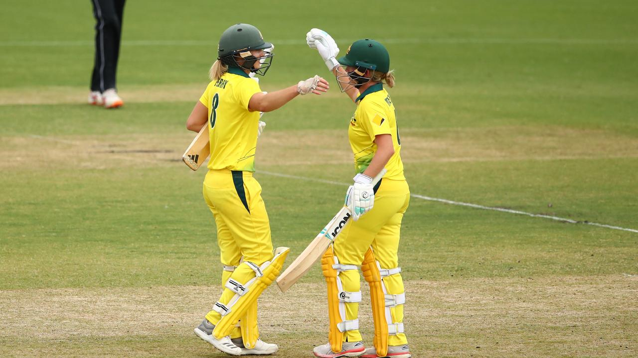 Ellyse Perry and Beth Mooney celebrate after hitting the winning runs to seal the clean sweep. Picture: Getty