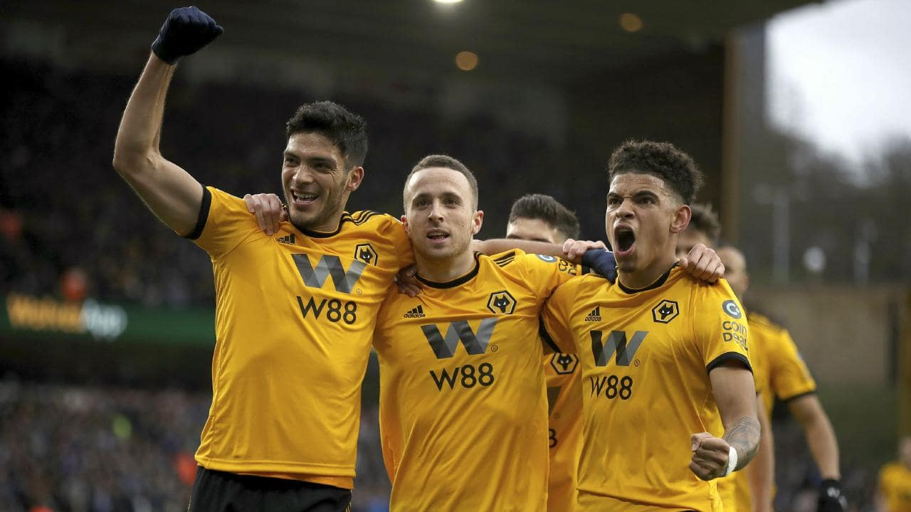 Wolverhampton Wanderers' Diogo Jota, center, celebrates scoring