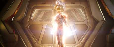 Carol Danvers lights up as Captain Marvel.