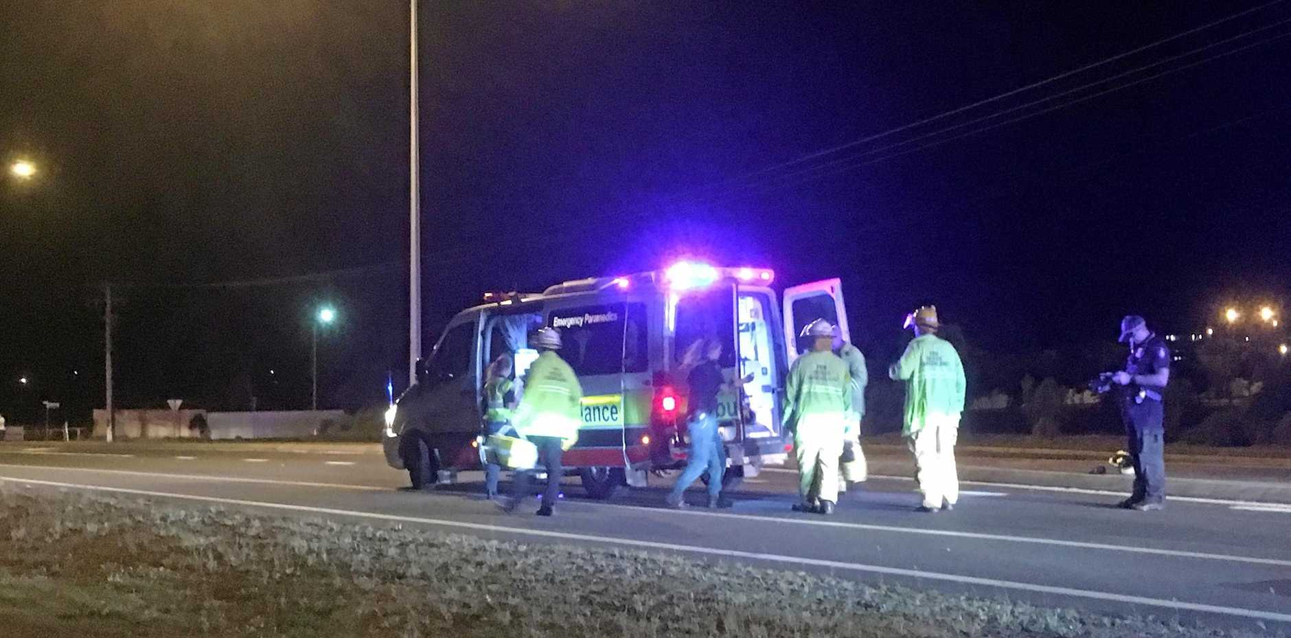 Emergency services personnel place an injured motorbike rider in an ambulance for transportation to Rockhampton Hospital on Sunday night.