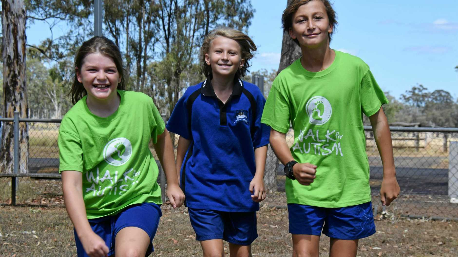 STRIDING OUT: Wheatlands State School students Olivia Fox, Cheyanne Lorne and Archer Hollands get in some training for the Walk for Autism fundraiser.