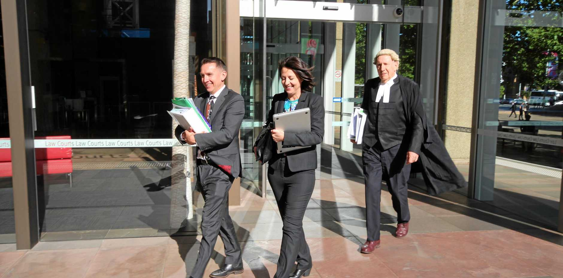Esther Rockett (centre) leaves Sydney Supreme Court with solicitor Stewart O'Connell and barrister Tom Molomby after the final hearing in the defamation case brought against her by Universal Medicine leader Serge Benhayon in December.