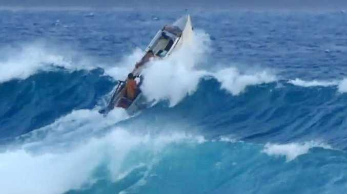 A large wave off Noosa took the boaties beyond recovery point on Sunday morning and they took on too much water when they landed to stay afloat.