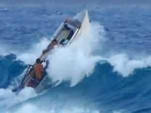 Fishermen's lucky escape after monster wave overturns tinnie