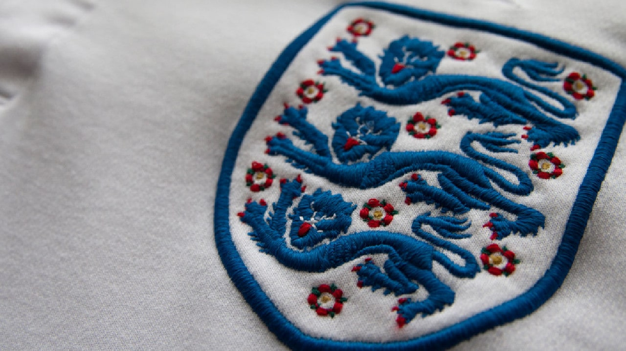 A married England footballer has secretly fathered a child with his mistress
