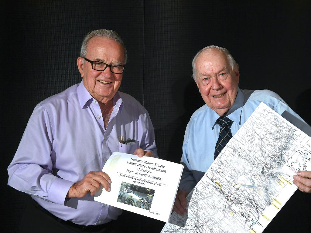 Sir Leo Hielscher and Sir Frank Moore with some of the maps and information about the planned water way from North Queensland to South Australia. Picture: AAP/John Gass