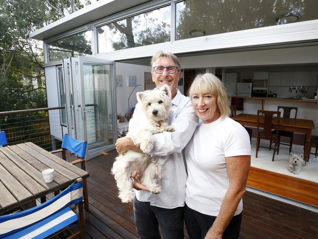 Sheridan Van Asch and David Burnett with Charlie, at their home in Woolloongabba, AAP/Josh Woning