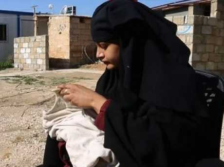 Shamima Begum with her baby boy in the al-Hawl refugee camp in Syria. Picture: Supplied