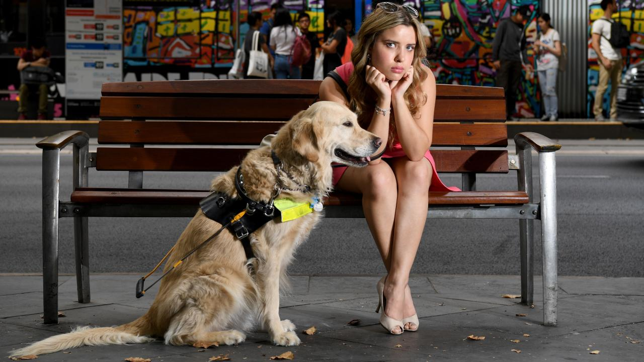Rachael Leahcar with her RSB Guide Dog Ella at the location where she was refused an Uber pickup. Picture: Tricia Watkinson