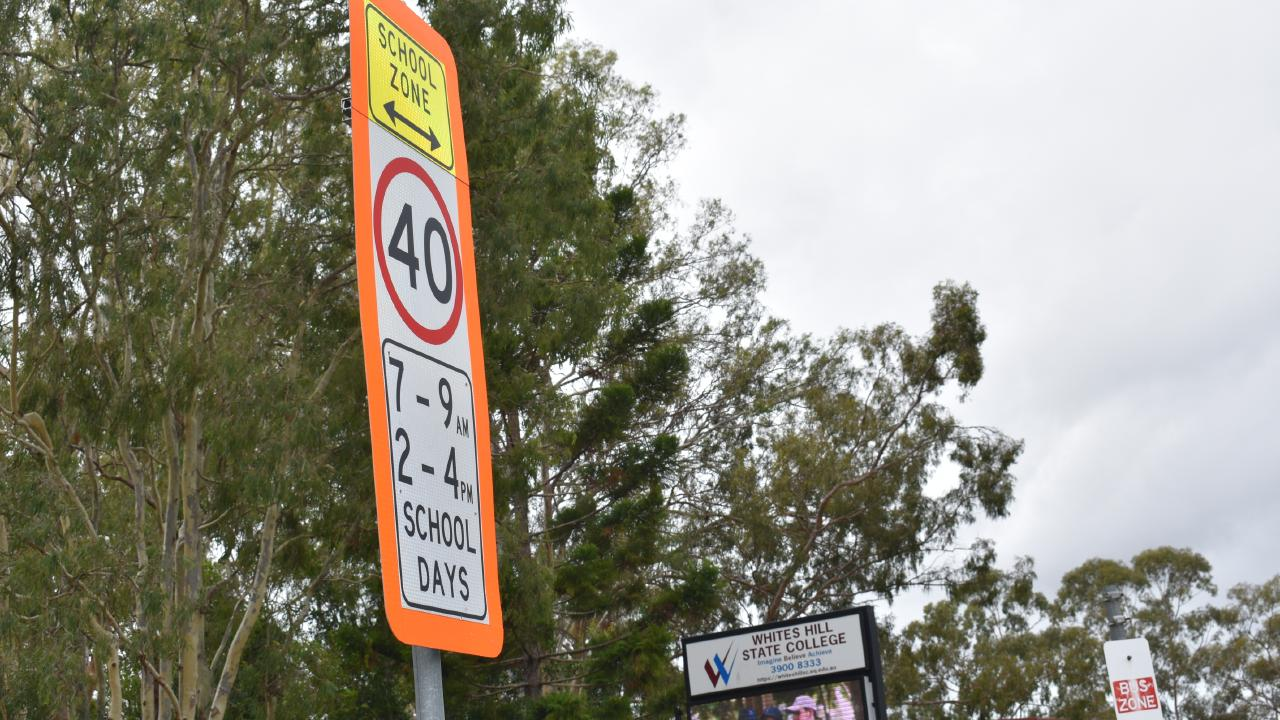 A standard school zone sign at the approach to Whites Hill State College on Samuel St.