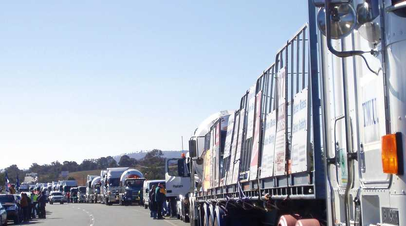 FIGHT A GOOD FIGHT: A 4km line of trucks takes on Canberra to fight for safe rates.