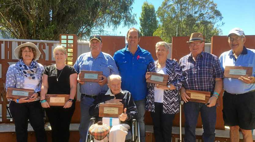 Celebrating the 2019 legends are (from left) John Moore represented by his daughters Lana and Christine, Sam Roberts, Glenn Kendall, Jack Peach represented by his daughter Cynthia, Graham Mirtschin, John Dyson and Ray Dennert (front).
