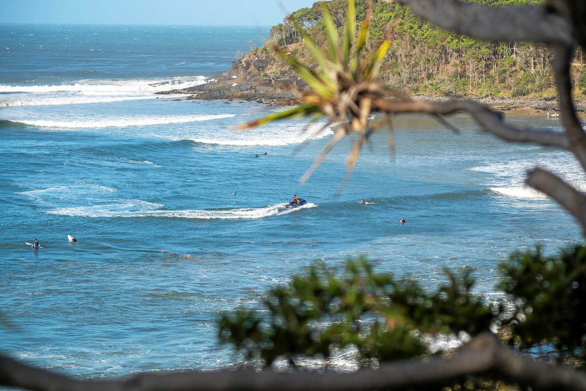 A jet ski rider picks up a surfer inside the line up at Tea Tree, on their way to another paddle-free wave during the Cyclone Oma swell.