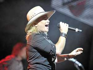Country music star Kate Cook's tumultuous upbringing