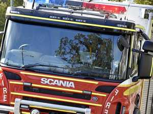 Small bushfire blocks traffic on busy Coast road