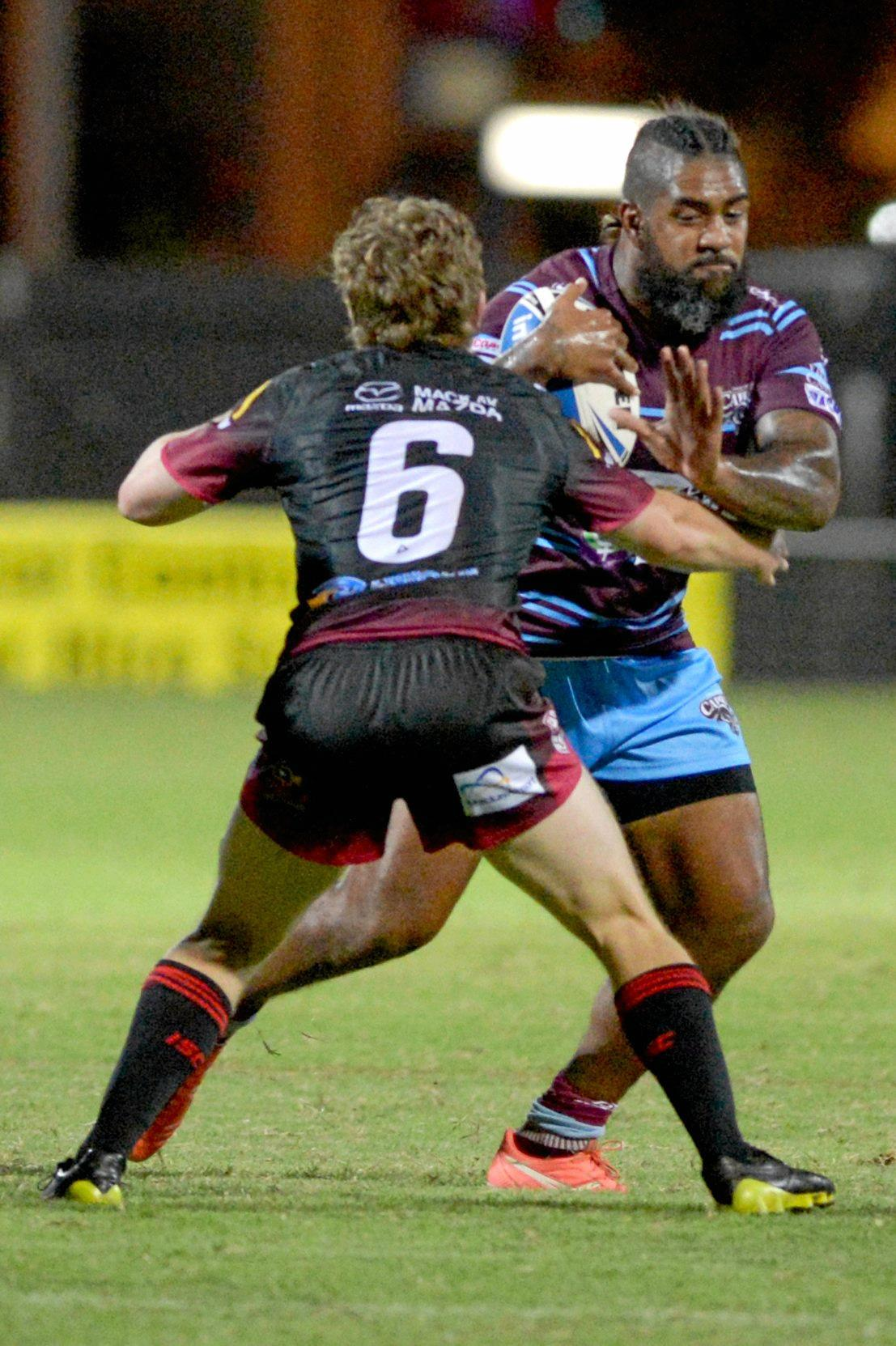 CQ Capras' Eddy Pettybourne charges into the Mackay Cutters defence in the trial game in which he broke his foot.