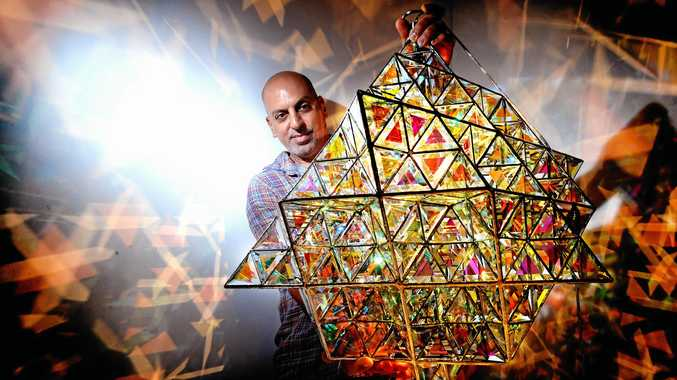 STUNNING CREATION: Local glass artist Asaf Zakay with his signature piece, the Tetra Matrix, in his studio in Bangalow.