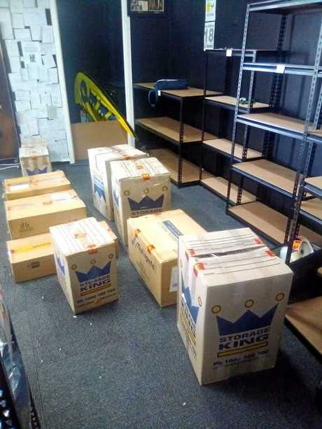 Boxes believed to contain the seized items line the floor of Bundy's 420 Emporium.