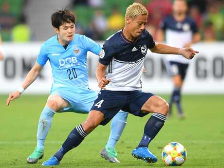 Keisuke Honda controls the ball in front of Hwang Soonmin of Daegu. Picture: Getty Images