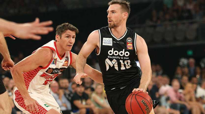 Mitch McCarron of Melbourne (right) has warned against the reigning champions putting too much of a focus on Wildcats guard Bryce Cotton.