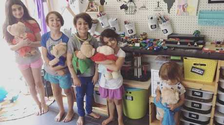 Ms Skinner's children and her rainbow daughter posing for a picture — as they 'unintentionally' left a space for Zayli, 'right where she would have stood'.