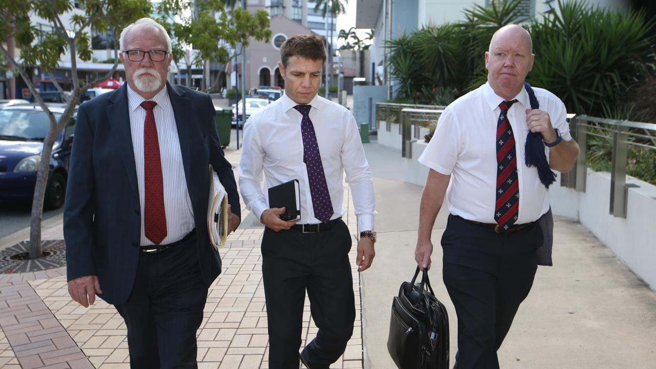 Michael Katsidis (centre) arrives at Southport Court with lawyer Chris Hannay and barrister Wayne Tolton. Picture Glenn Hampson