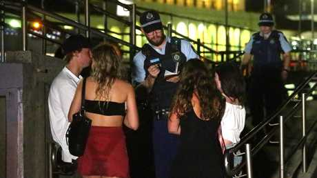 The man was checked by paramedics as a precaution before being reunited with his clothes and friends. Picture: Bill Hearne