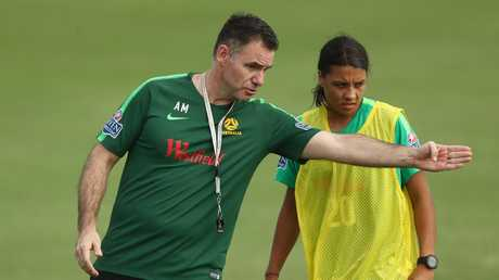Milicic talks with Sam Kerr during training. Picture: Getty