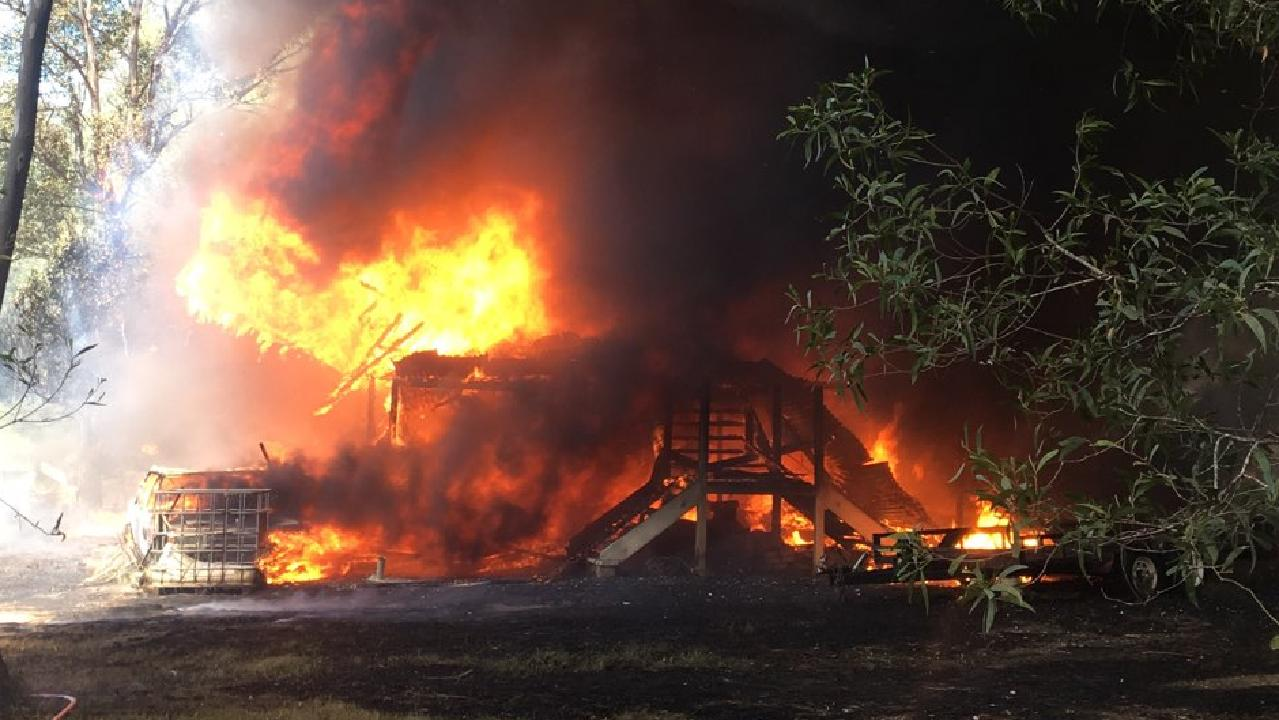 A house fire at Cedar Creek has destroyed a house, five cars and a boat