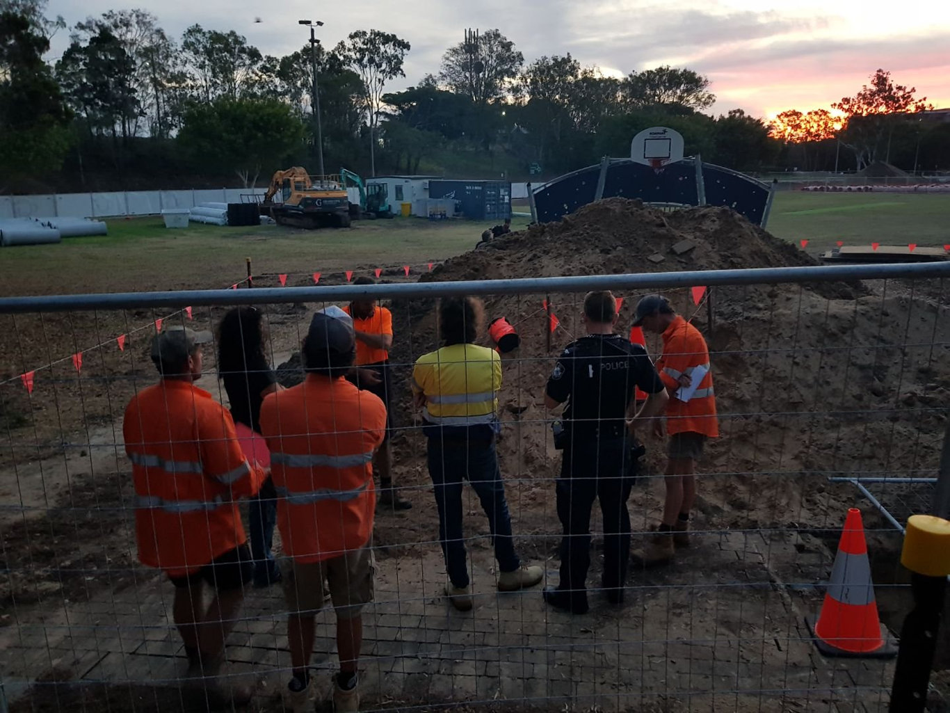 Construction workers and police officers on the scene of a construction site at Seafront Oval where bones have been discovered.